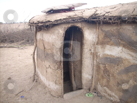 Entrance to Masai Manyatta stock photo, A front view of a Masai manyatta with small low doorway. by Rose Nthiwa