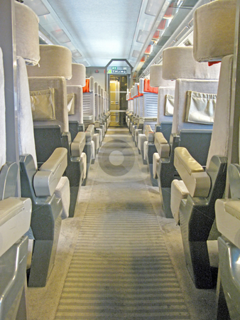 Train Seats stock photo, An aisle of a train with a lot of seats. by Lucy Clark