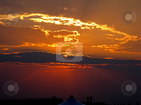 Golden Sunset stock photo, A red and golden burning sunset with clouds. by Lucy Clark