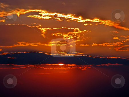 Burning Sunset stock photo, A red and golden burning sunset with clouds. by Lucy Clark