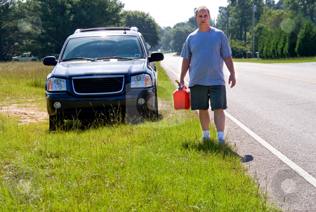 Out of Gas stock photo, A man who has run out of gas with a gasoline can. by Robert Byron