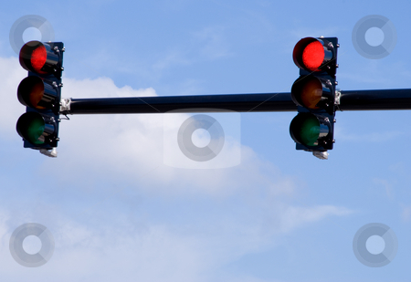 Traffic Light stock photo, A traffic light over a busy intersection. by Robert Byron