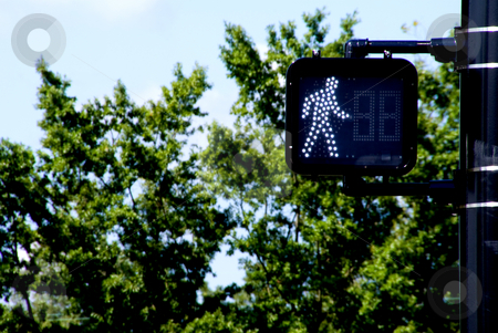 Walk Signal stock photo, A walk signal mounted to a street lamp pole. by Robert Byron