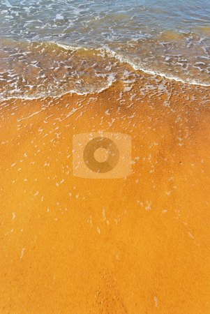 Flood water on the beach stock photo, Golden beach with just some waves at the North Sea by Wino Evertz