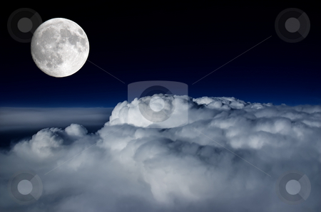 Full moon above cloud deck stock photo, Full moon lighting up the clouds below by Pierre Landry
