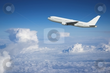 Airliner climbing above the clouds stock photo, Large airplane climbing above the clouds shortly after take-off by Pierre Landry