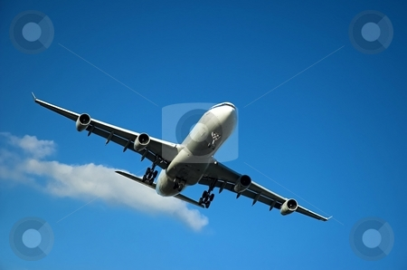 Jumbo jet landing stock photo, Airplane approaching to land during sunny day by Pierre Landry