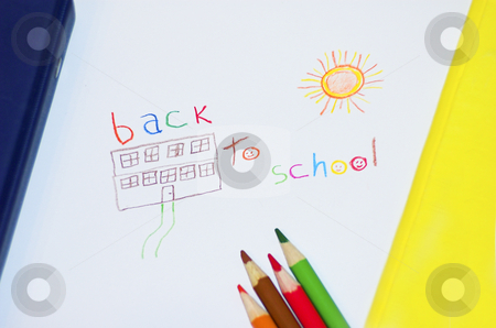 Back to school stock photo, Kid's drawing of a school with back to school lettering and framed by binder and duo-tang by Pierre Landry