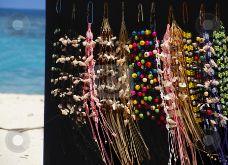 Jewerly stock photo, Beach vendor selling beautiful colorful jewerly by Maria Alessandra Nusiner
