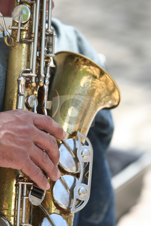 Saxophone player stock photo, Musician playing saxophone in the street by Gautier Willaume