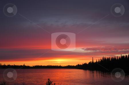Fiery Sunrise stock photo, Glowing sunrise reflecting in small lake by Pierre Landry