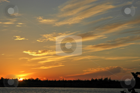 Orange Sunset stock photo, Colorful orange sunset in northern Canada by Pierre Landry