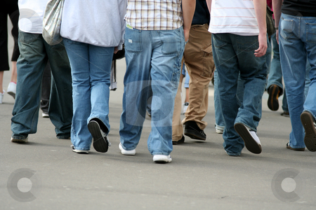 Teens group legs walking in the street stock photo,  by Gautier Willaume