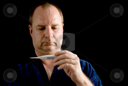 Fever stock photo, A man checking his temperature with a thermometer. by Robert Byron