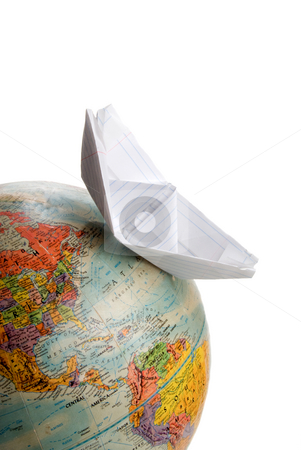 World Travel stock photo, A boat sailing across a globe of the world. by Robert Byron