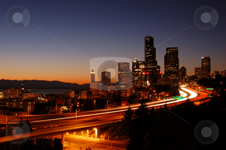 Cityscape and freeways stock photo, A beautifully illuminated painting like night shot of downtown Seattle with the freeways in foreground by Nilanjan Bhattacharya