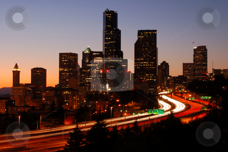 Silhoutted Seattle downtown stock photo, A silhouttle of the Seattle downtown with colorful freeways in foreground by Nilanjan Bhattacharya