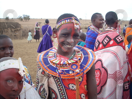 Beautiful Masai Girl smiling stock photo, Beautiful Masai girl in traditional dress and red ocre on face smiling. by Rose Nthiwa