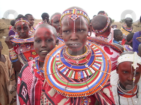 Beautiful Masai Girl in tradional dress stock photo, Beautiful Masai girl in traditional dress standing in a crowd. by Rose Nthiwa