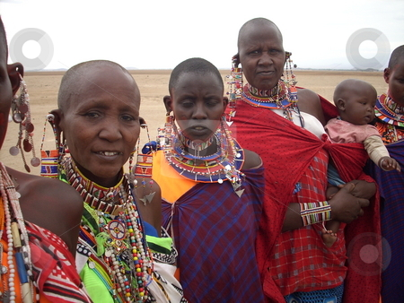Masai women with baby stock photo, Masai women in traditional gear holding baby. by Rose Nthiwa