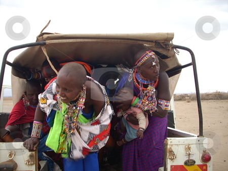 Masai Women with baby hitch a ride stock photo, Masai women with baby hitch a ride in the back of a pick-up by Rose Nthiwa