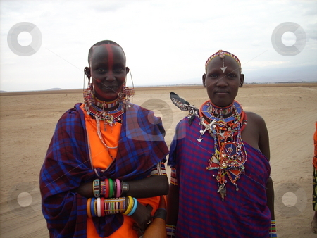 Two young Masai women in traditional dress stock photo, Two beautiful young Masai women dressed in traditional clothes by Rose Nthiwa