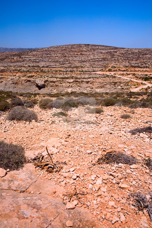 Dry Soil stock photo, A dry soil landscape in malta by Tyler Olson