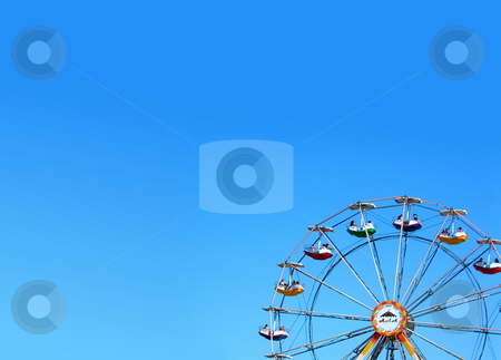 Ferrisweel stock photo, A Ferrisweel with a blue sky in the background. by Henrik Lehnerer
