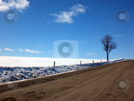 Country road at end of winter stock photo,  by J.G. Byers