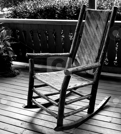 Rocking chair stock photo, Rocking chair on front porch by Anita Peppers