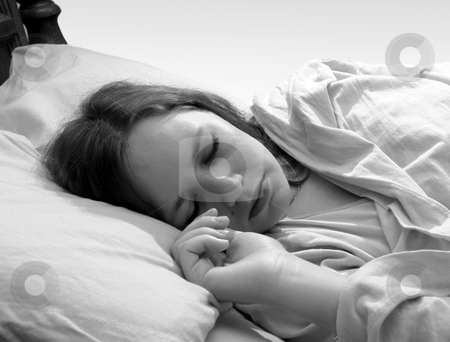 Woman sleeping stock photo, Young woman asleep in bed by Anita Peppers