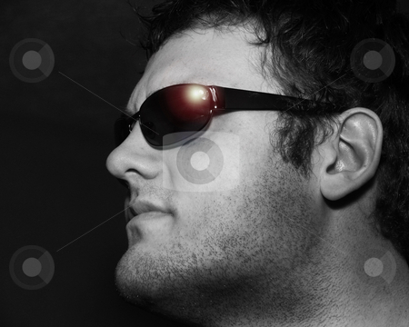 Confident Young man stock photo, Self confident young man with sunglasses in black and white with sun reflection in glasses by Anita Peppers