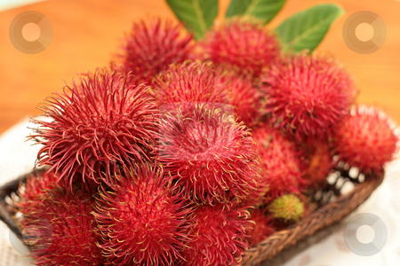 Rambutan fruits stock photo, A tray of red hairy rambutan fruits by Jonas Marcos San Luis