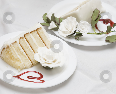 Wedding cake stock photo, Two pieces of a wedding cake on different plates by Vlad Podkhlebnik