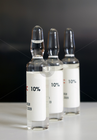 Ampoules stock photo, Close up of doses or vaccines in ampulles for medical treatment. by Sinisa Botas