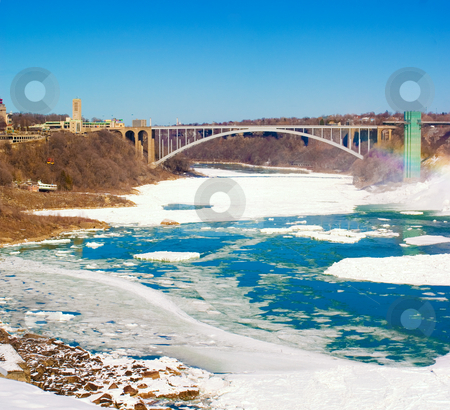 Rainbow Bridge, Niagara Falls stock photo, Rainbow Bridge at Niagara Falls in the winter with ice and snow on the river by Johan Knelsen