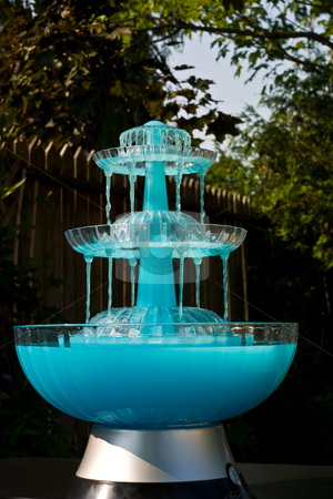 Blue Drink Fountain stock photo, Dark blue fountain with a cool drink cascade by Johan Knelsen