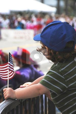 Fun at the Parade stock photo, Little boy at a parade. by Timothy OLeary