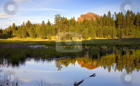 Kloochman Evening stock photo, Kloochman Rock reflected in a small spring pond as the sun sets on a sprng day behind me by Mike Dawson