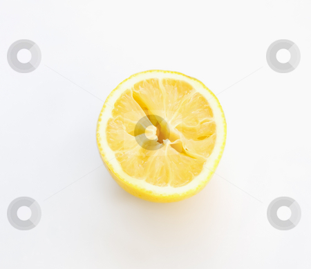 Half of lemon stock photo, Just a half of aged and juicy lemon on a clear background by Sinisa Botas