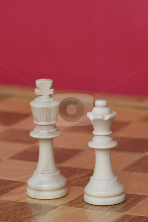 White King & Queen stock photo, White king and queen from a game of chess on a chess board by Inge Schepers