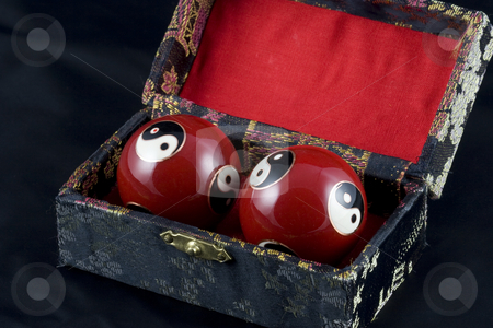 Yin and Yang Baoding Balls stock photo, Yin and Yang Baoding balls, also known as health balls, in a small embroidered box by Inge Schepers
