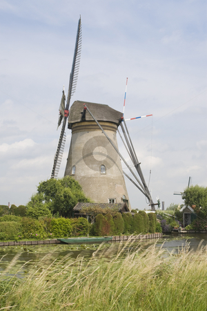 Dutch Windmill stock photo, Dutch windmill with a canal in the foreground by Inge Schepers