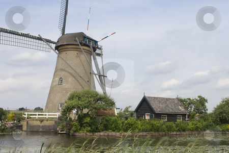 Dutch Windmill and Shed stock photo, Dutch windmill and shed with a canal in the foreground by Inge Schepers
