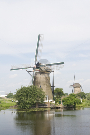 Dutch Windmills stock photo, Dutch windmills with a canal in the foreground by Inge Schepers