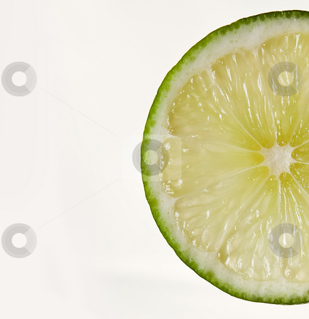 Lime slice stock photo, A slice of lime, isolated on white by Paul Hakimata