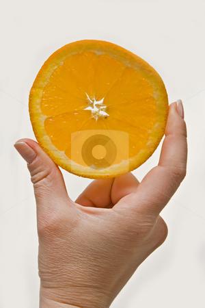 Orange wedge stock photo, Woman hand holding up an orange, tangerine of mandarin wedge, isolated on white by Paul Hakimata