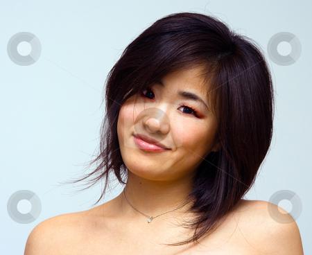 Beautiful sexy Oriental woman stock photo, Beautiful sexy Oriental woman with bare shoulders laughing by Paul Hakimata