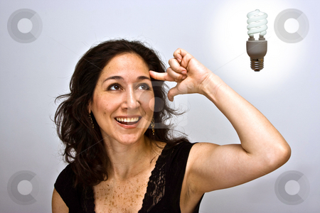 Think environment stock photo, Woman having a brilliant environmentally friendly thought by Paul Hakimata