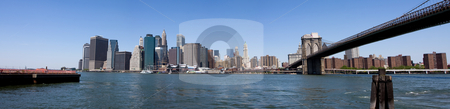 Manhattan Financial District stock photo, Panorama of the Financial District in Manhattan, New York City, under a deep blue sky on a bright sunny day. View from Fulton Ferry Landing in Brooklyn. by Paul Hakimata